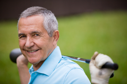 Senior man holding golf club