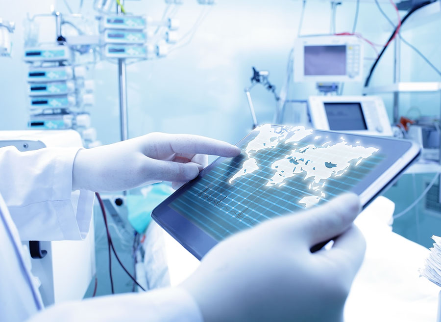 28172766 – doctor working with tablet pc and world map. the concept of medicine