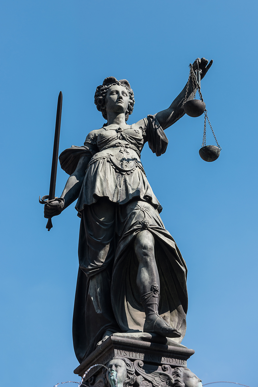 justitia on blue sky background