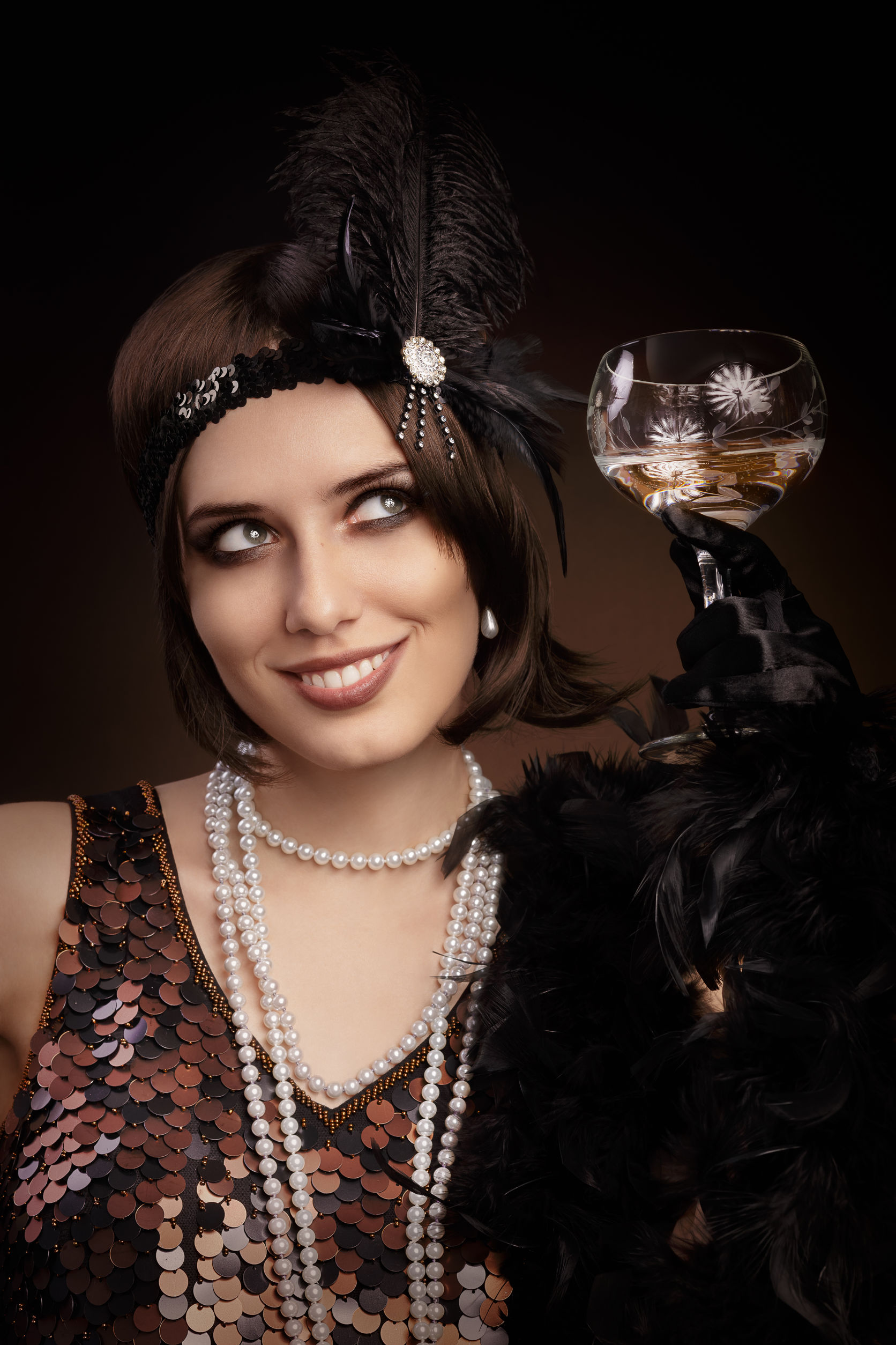 33260253 – portrait of a flapper girl with a glass of champagne
