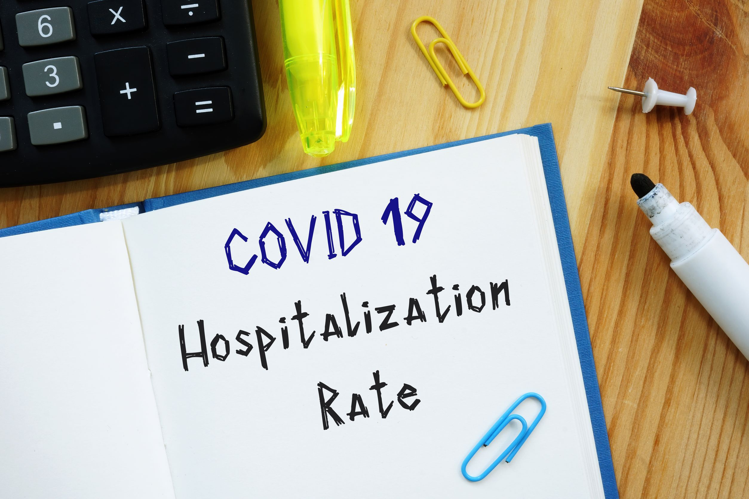 Conceptual photo about covid hospitalization rate with handwritten phrase.